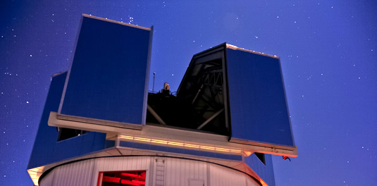 The Discovery Channel Telescope site at night with the Pleiades
